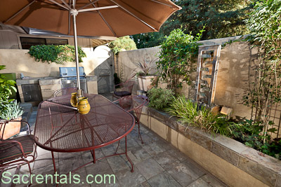 Dining Patio Off The Kitchen Built In Gas Grill And Fountain Italian Limestone With Night Lighting