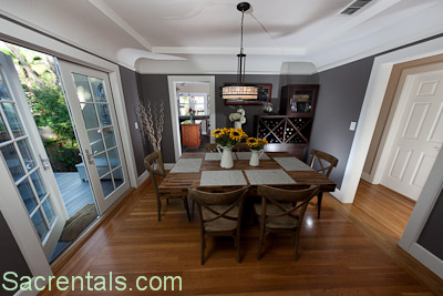 Formal Dining Room With Adjoining Gourmet Kitchen And French Doors Opening Onto A Garden Side Deck