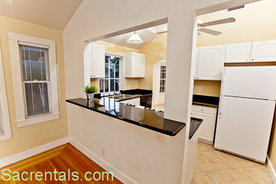 Granite Kitchen With Breakfast Bar And Built-ins. Cathedral Ceilings -  Skylights - Decorator Lighting