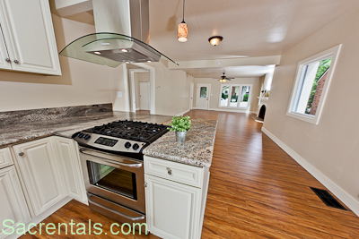 Open Concept Stainless / Granite Kitchen With Hardwood Floors   Stainless  Side By Side Refrigerator   Convection Gas Range Euro Style Range Hood   ...