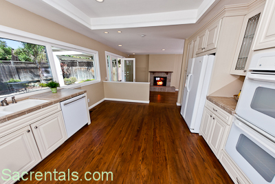 Open Concept Tumbled Tile Kitchen With Gourmet Jenn Aire Gas Cook Top