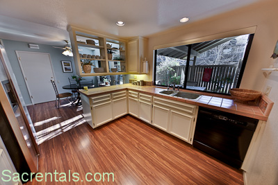 Open Plan Kitchen Dining Breakfast Room Area With Hardwood Floors And Walk Out To The Front Enclosed Patio Garden
