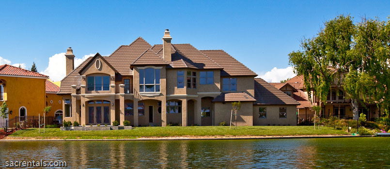 normandy style laguna lake estates lakeside mansion with100 plus feet