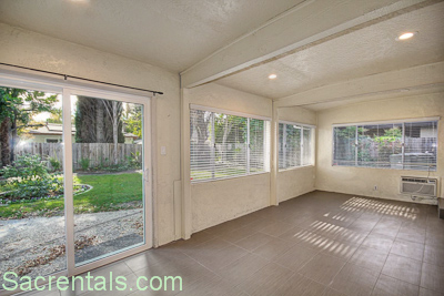 Exceptional Backyard View Looking Towards The Enclosed Patio Bonus Room And Covered  Dining Patio