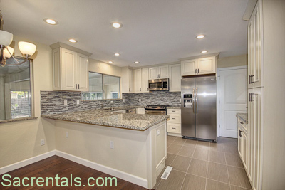 Open Concept Family Room And Kitchen Dining Area With Fireplace Refinished Wood Floors Access To The Backyard Adjoining Enclosed Garden Bonus