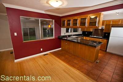 Open Concept Dining Living Room With Hardwood Floors Front Yard View