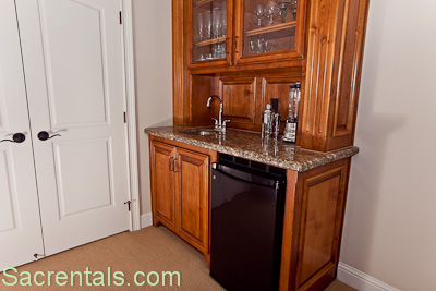 granite wet bar with under cabinet and sink