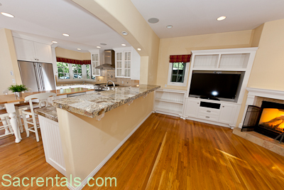Granite Breakfast Bar With Adjoining Open Plan Kitchen Dining Family Room