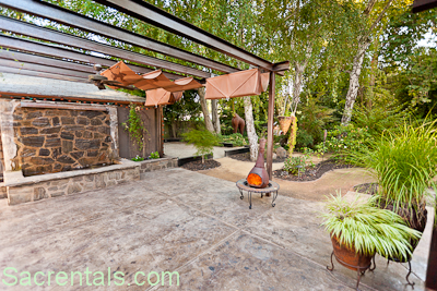 Exceptional Backyard View   Water Wall Fountain   Free Standing Garden Fireplace   Retractable  Sun Shades Extending Over The Dining Patio With Garden Views And ...