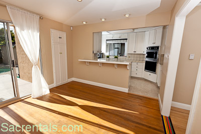 Dining Room With Open Plan Breakfast Bar And Adjoining Kitchen