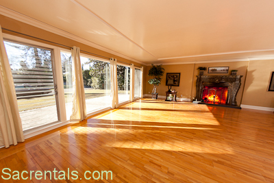 Room Cherry Hardwood Floors And With Massive Granite Fireplace