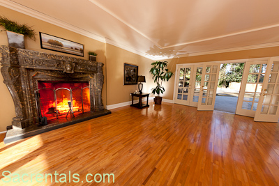Formal Living Room With Massive Granite Fireplace