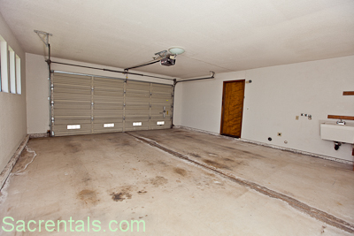Two Car Garage With Opener   Laundry Hookups And Utility Sink   Extra Deep  Garage   Access To The Kitchen