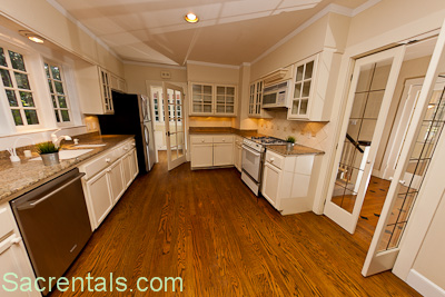 Granite Gourmet Kitchen With Stainless Silent Series Dishwasher And Refrigerator