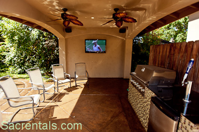 Beautiful Alfresco Dining Patio With Outdoor Kitchen. Stainless Pro Gas Grill   Beer  Tap Refrigerator. Recessed Night Lighting   Empire Style Ceiling Fans