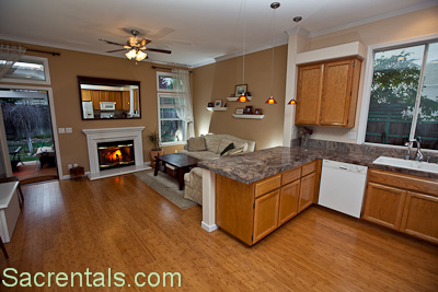 Open Concept Kitchen And Family Room With Fireplace And Breakfast Dining  Nook And Breakfast Bar